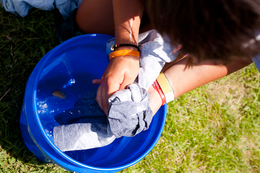 Students learned how the villagers must conserve water while washing their laundry.
